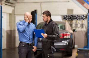 Mechanic Showing Invoice